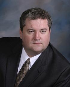 John D Mikuzis, DO